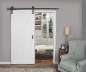 A picture of a L057 pre-finshed white sliding barn door.