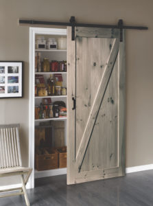 A picture of a L057 sliding barn door in a kitchen.