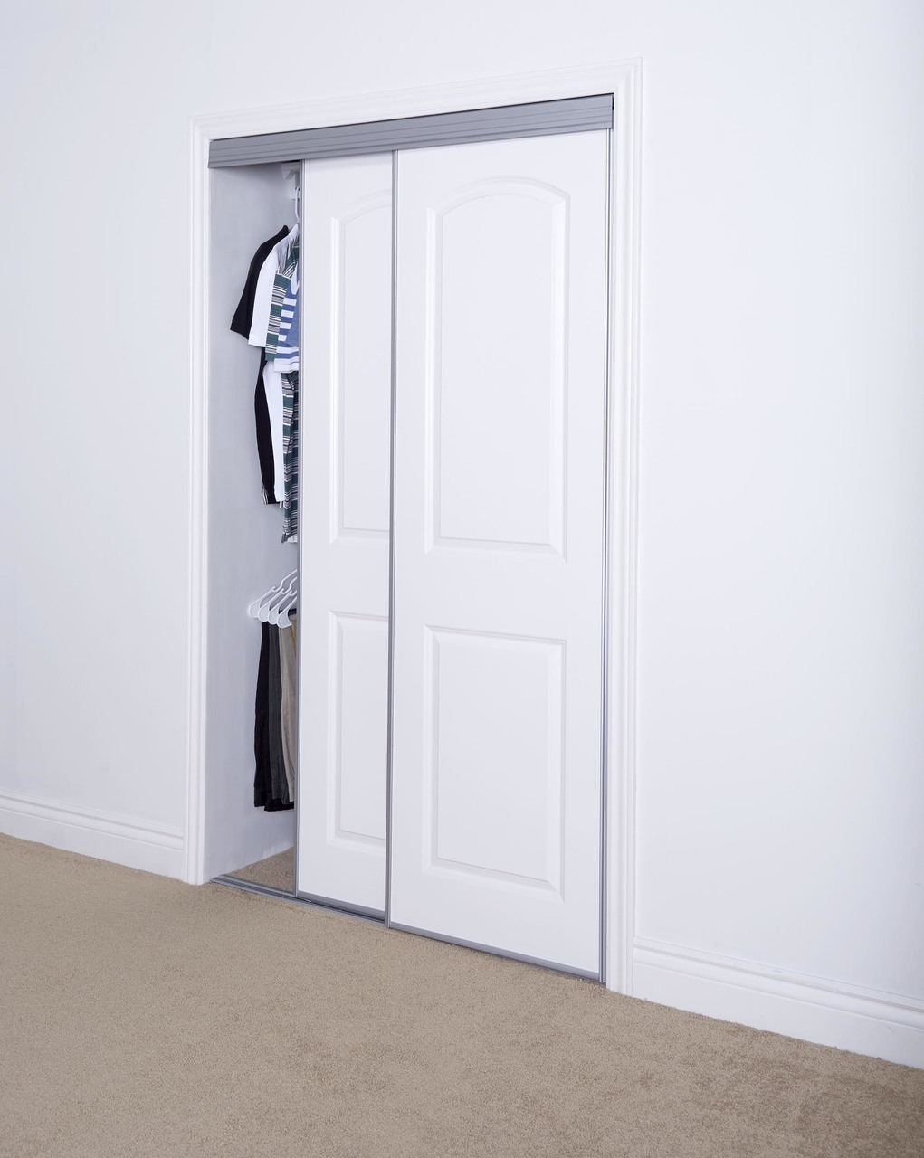 Sliding Bypass Door With Primed 2 Panel Curved Top Design