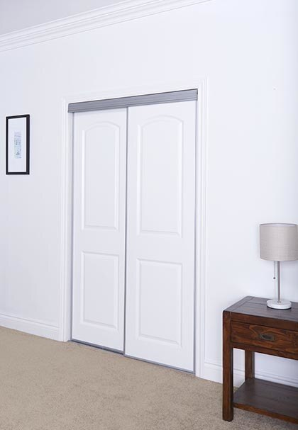Sliding Bypass Door With Primed 2 Panel Arched Top Design