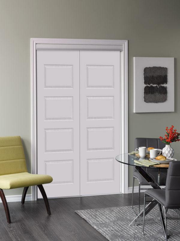 Beautiful solid white modern door with a chair beside it and a small table with tea cups and red flowers