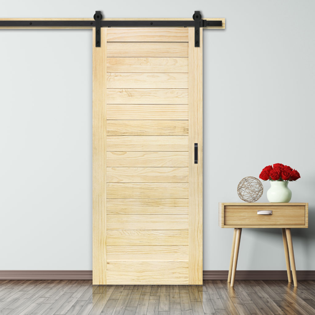 Unfinished barn door horizontal plank design in a room with matching side table