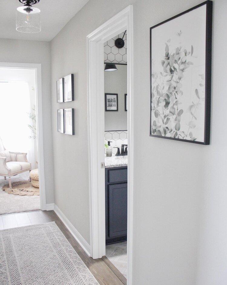 Doorway with no door opening into a modern white bathroom.