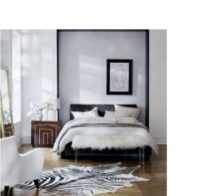 Modern bedroom with grey and black features and a white bed.