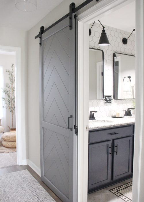 Kelsey Mansingh Installed our Gatsby Mix & Match Hardware Barn Door Kit for Guest Bathroom